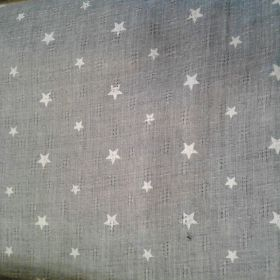 Tissu étoilé fond gris