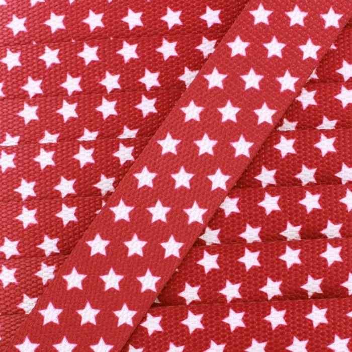 Sangle avec étoiles sur fond rouge